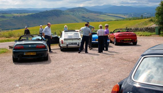 This photo shows a group of members at the car park to the Neil Gunn memorial at Strathpeffer, on part of a Club run around the Black Isle.