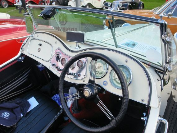 The interior and dashboard of a 1952 MG TD.