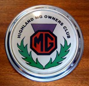For the benefit of recently-joined members the badge, as shown in this photo, is enamelled onto a disc of chromed metal and is available in either Bar Mounting or Grill Mounting format. The price remains unchanged at £10 each.